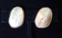 "Pair Vintage CHICO'S Modernist Asymmetrical Oval Bronze & Metallic-Finished Abalone Clip-On Earrings    Presented here for your admiration and consideration is a Pair Vintage CHICO'S Modernist Asymmetrical Bronze & Metallic-Finished Abalone Clip-On Earrings. This item is sure to make an exceptional addition to any antique/vintage jewelry collection.     Measurements are: Length--1.5"" Width--1"" 