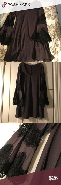 Grey A-line Dress This Express dress can we worn casually with leggings and combat boots or it can be dressed up with a pair of heels and tights! Super comfortable and stretchy fabric with beautiful lace detail in the bell sleeve. Express Dresses Long Sleeve