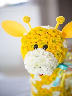 Use button mums and floral foam to create flower animals