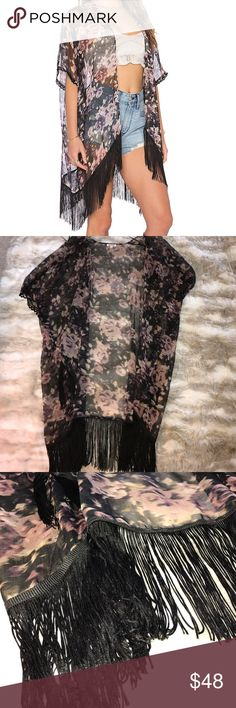 Floral Kimono The perfect lightweight accessory to your warm-weather outfits! Includes cool fringe on the bottom and lace detail on the sleeve. Lends to a boho-chic look; pair it with high waisted shorts and a crop top or over a flowy ivory mini dress for the layered look. Only worn twice! LA Made Tops