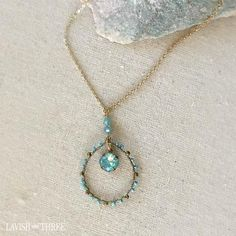 Elegant, delicate gold short necklace with a large blue gemstone pendant.  Designed by Lavish Three.  Would make a thoughtful Valentine's or Mothers day gift for her! Check out our exclusive line of unique one of kind necklaces and bracelets.