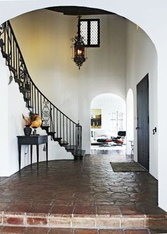 We love nothing more than a beautiful entryway, and this one certainly is grand. The wear in the tiles is all original, along with the circular-shaped architecture that really highlights the...