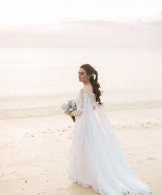 Beautiful bride, beach wedding, white dress, sunset.
