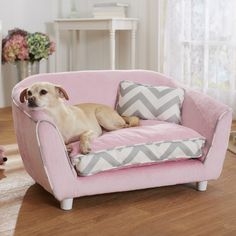 This adorable pink sofa-style pet bed features a super soft micro-velvet material, back storage pocket for toys and stylish gray chevron print detail. Great for small to medium size dogs and cats alike, your pet will love having their very own couch!