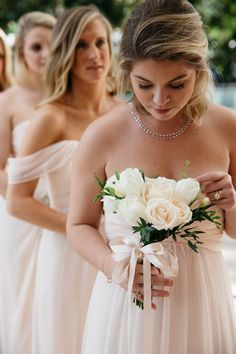 Small white rose and tulip bridesmaid bouquet with ribbon