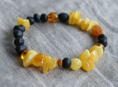 This is a wonderful asymmetric bracelet for women made from mixed amber beads with screw clasp Length of bracelet is about 7 inches Why Baltic Amber?  Baltic amber is a fossil resin produced by ancient pine trees, which grew in Northern Europe, around the Baltic sea as long as 300 million years ago. As the climate warmed the conifer trees began exuding large amounts of resin and as the millennial progressed, these exudation's became stable. Natural Baltic amber is considered the very finest…