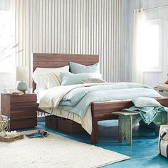 Crafted from reclaimed saal wood, the Stria Bed brings rustic charm to the bedroom. In a former life, the wood was used in Indian railway trestles...