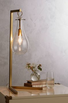 Crafted of glass with a wooden base, our exclusive Edison Glass ...