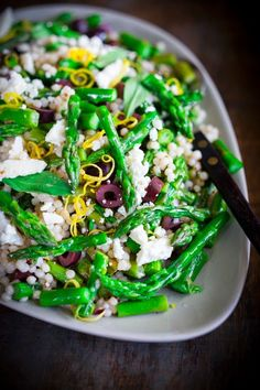 Vegetarian Spring Asparagus Salad | Salad Ingredients: Asparagus, Cous Cous, Kalamata Olives, Feta Cheese, Pine Nuts, Mint (Tarragon or Italian Parsley), & Lemon Zest. Dressing Ingredients: Olive Oil, Whole Grain Mustard, Red Wine Vinegar, Lemon Juice, Salt, & Pepper. | Feasting at Home