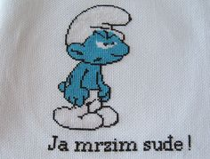 Grouchy Smurf in counted cross-stitch. No pattern but maybe I can work it out?
