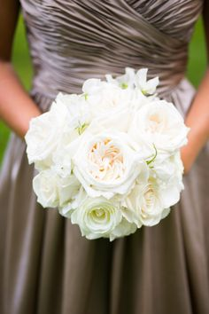 All white bridesmaid bouquet | Boston Wedding at the Four Seasons  Read more - http://www.stylemepretty.com/massachusetts-weddings/boston/2013/12/27/boston-wedding-at-the-four-seasons/