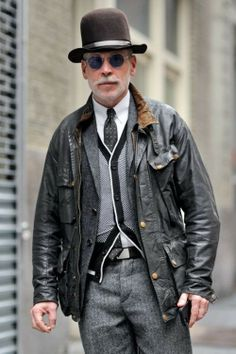 Shop Nick Wooster's look for $297: http://lookastic.com/men/looks/dress-pants-and-bomber-jacket-and-dress-shirt-and-tie-and-cardigan-and-blazer-and-hat-and-belt/2168 — Grey Herringbone Wool Dress Pants — Black Leather Bomber Jacket — White Dress Shirt — Black and White Polka Dot Tie — White and Black Cardigan — Grey Wool Blazer — Black Hat — Black Leather Belt