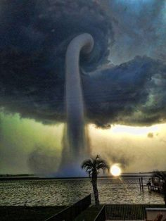 A waterspout in Tampa, FL...basically, these are tornadoes connected to a cumuliform clouds that occur over bodies of water. Nature is amazing.