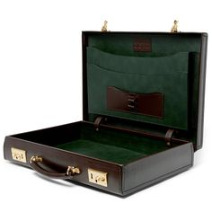 """Kingsman + Swaine Adeney Brigg Leather Briefcase - Craftsmanship techniques used by Swaine Adeney Brigg have remained virtually unchanged since the early 19th century. Designed in collaboration with Kingsman , this attaché-style briefcase has been made in Northamptonshire from smooth brown bridle leather. The hardware has been hand-polished to enhance """"the natural grandeur and strength of the brass"""" and the handle is made up of eight individually sculpted and hand-sewn components."""