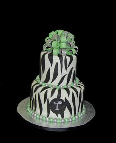 2 tier zebra print 50th birthday cake with green and silver accents by Simply Sweets, via Flickr