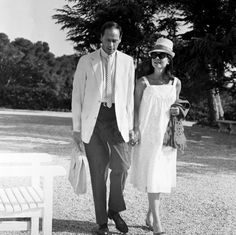 A pregnant Audrey Hepburn with her husband Mel Ferrer on vacation in Antibes, France, May 1960.