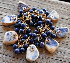 Blue and White Sea Pottery Bracelet Lapis by OceanCharmsSeaGlass. Love how the wire coils are glued on rather than the piece being drilled.
