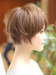 Graduated short bob, wispy edges, uhhh and you need this beautiful long neck...