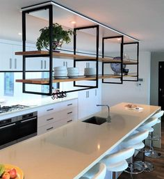 This stylish and practical shelving system suspended from the ceiling is the Industrial Kitchen Gantry from Casa Cielo Design. Kitchen Room Design, Home Room Design, Modern Kitchen Design, Interior Design Kitchen, Home Decor Furniture, Furniture Design, House Rooms, Home Kitchens, Kitchen Remodel