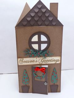http://amyscraftingspace.blogspot.com/2011/12/seasons-greetings-house-shaped-card.html