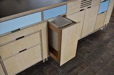 pull out garbage drawers by Kerf Design