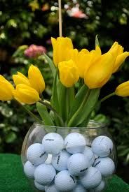 golf centerpiece. I have used this centerpiece. Put a golf flag (hole19)on a dowel stick and insert into this centerpiece. Too cute.