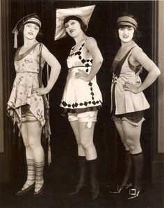 1920s, bathing beauties dressed for a day at the beach... and yes, they used to wear stockings and shoes into the water! At least, those who could afford them did.
