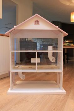 """I drilled 2.5"""" holes between all the sections, and added PVC tubing to protect to wood from nibbly hamsters. The top section had no ventilation, so I made the front surface out of hardware cloth. The bottom two floors (and an inch of the top) is clear plexiglass."""