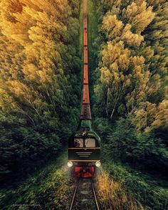 Narrow-gauge railway and small train riding down the hill. One of my most…