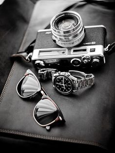vintage camera, sunglasses, and watch. manly accessories