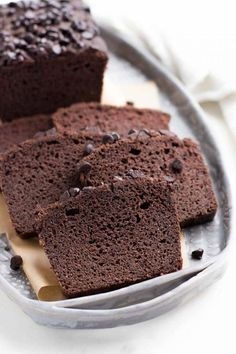 A low carb chocolate pound cake made of coconut flour and baked in a loaf pan. Perfect for any sugar-free or keto diet.