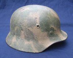 WWII Headgear WWI headgear Antique Military headgear http://www.collectorsmilitaria.com/headgear.html