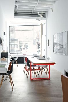 Modern live work space in Toronto with office table by Made, sneaker-inspired Shoe Toss pendants by Jeremy Hatch of Ricochet Studio.