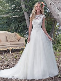 Maggie Sottero - CHANDLER, A stunning illusion lace neckline takes center stage in this ball gown wedding dress, with enchanting lace bodice and flowing tulle skirt. A breathtaking illusion lace keyhole back adds a dose of drama. Finished with dainty cap-sleeves and zipper closure.