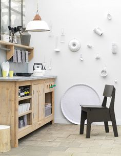 Creative use of thrift store objects to keep your wall white but give it some character.