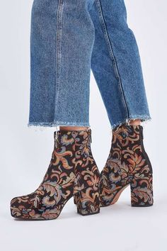 Make a statement in these edgy ankle boots in tapestry print. Comes with a platform for extra height. A perfect pair of heels that work well both day and night. #Topshop