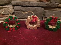 Wine Cork Wreaths! Wreaths are made with wine corks, green or gold paint, glitter, pom poms, bows, wrapped in Christmas ribbon and attached with gold or silver ribbon hook to hang for an ornament. THESE CAN BE PURCHASED WITH OR WITHOUT THE ORNAMENT HOOK. If you dont want it as an