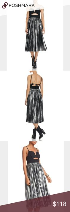 "Free People Pleated Midi Dress Striking from every angle and poised for center stage, Dress balances a structured bandeau bodice with alluring cutouts over a shimmering metallic skirt that's treated to chic shutter pleats.  Bodice: nylon/cotton/spandex; bottom: polyester; lining: cotton/spandex Notched square neck, slender shoulder straps, bandeau bodice Empire waist, front and back cutouts, all-around pleated skirt Back string tie, concealed back zip at skirt Approx. 45"" from back of neck…"