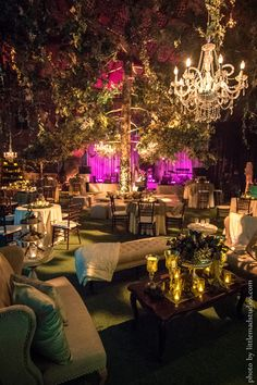 """An intimate guest list doesn't mean you have to cut down on the wow-factor. Says Melony Sebastian of Pink Monkey Solutions, """"We were creating an evening of enchantment for just 45 guests, so we rented a huge tree from a Hollywood prop house and erected it in the middle of the reception!Related: 130  Spectacular Decoration Ideas"""