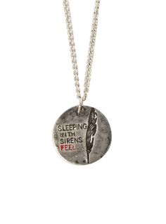Necklace with a Sleeping With Sirens Feel disc pendant.