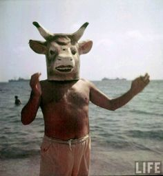 Picasso wearing a cow's head at Golfe Juan near Vallauris by Gjon Mili