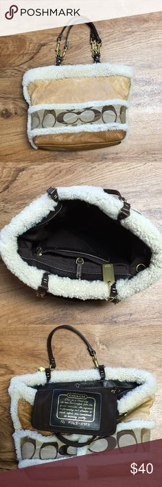 Authentic Coach handbag Coach handbag with soft leather and sheep skin fur trim. Brown leather shoulder straps clasp closure. Clean inside. Shows minimal wear. Great condition.  14 inches across 10 inches deep. Coach Bags Shoulder Bags