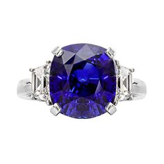 Betteridge Sapphire ring in platinum with diamond side stones. Cushion-cut sapphire weighing 12.05 carats