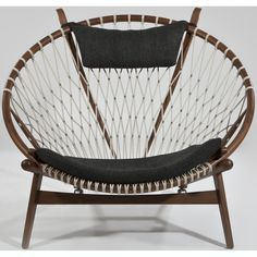 Hans Wegner Hoop Chair - With its distinctive, contoured design and use of natural materials, the Hans Wegner Hoop Chair provides the perfect balance of everyday comfort and ...