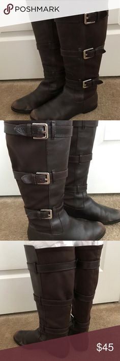 Calvin Klein Tall Brown 'Hillary' Riding Boots 7👢 Calvin Klein Hillary boots size 7. These boots are super comfortable and have a stretch material along the back. Genuine chocolate brown leather front and straps. The boots have 3 silver buckles along each side. The boots show wear on the toes, as shown in the pictures. *The boots do not stand up on their own as shown in the pictures* They need to be filled with tissue paper or being worn to stand up. Please feel free to ask any questions…