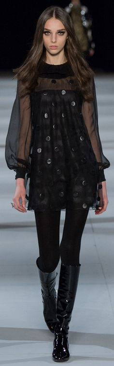 Yves Saint Laurent RTW F/W 2014-2015. Does this woman look like a familiar actress or something...?
