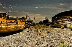 Ship graveyard near the port by Insomnes