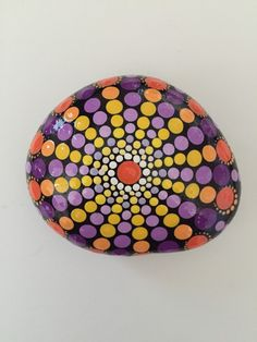 A personal favorite from my Etsy shop https://www.etsy.com/listing/293221693/mandala-stone-hand-painted-rock-dot