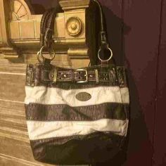 Dolce & Gabbana Purse Never really used. In good condition. No marks or scratches. Price is negotiable. A sort of off white color with bronze colored stripes. Dolce & Gabbana Bags Shoulder Bags
