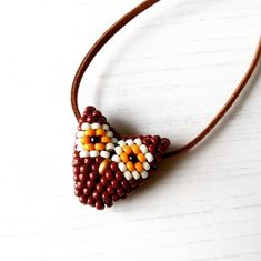 """Fun and vegan-friendly beaded """"critter"""" pendants available from The British Craft House Craft House, Home Crafts, Arts And Crafts, Uk Sites, British, Wise Owl, Owl Necklace, Owl Pendant, Vegan Friendly"""